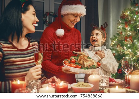 Merry Christmas! Happy family are having dinner at home. Celebration holiday and togetherness near tree. #754838866