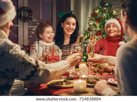 Merry Christmas! Happy family are having dinner at home. Celebration holiday and togetherness near tree. #754838884