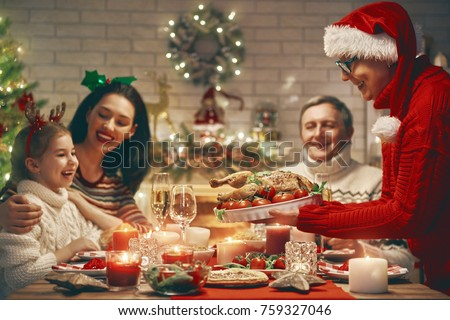Merry Christmas! Happy family are having dinner at home. Celebration holiday and togetherness near tree. #759327046
