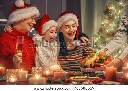 Merry Christmas! Happy family are having dinner at home. Celebration holiday and togetherness near tree. #763688569