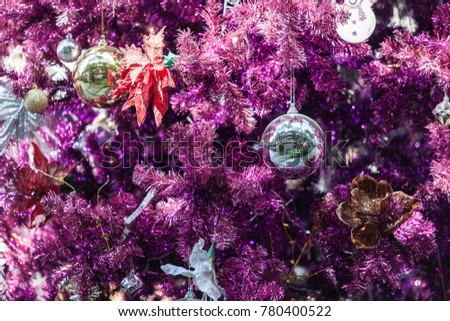 merry christmas happy new year event decoration of purple christmas tree and shiny ball