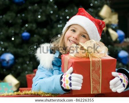 Merry Christmas - Little girl with Christmas gift