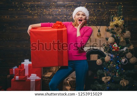 Merry Christmas. Merry Christmas and Happy New Year. Winter woman wearing red Santa Claus hat. New year presents #1253915029