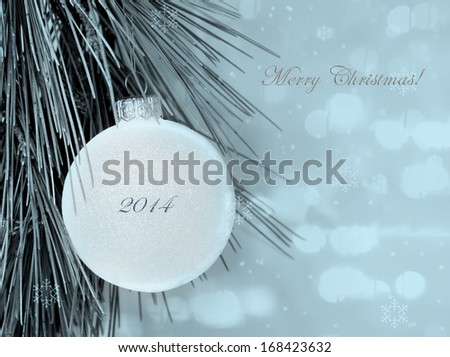 Merry Christmas postcard with simple decoration ball and blurred background