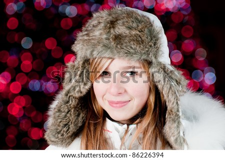 Merry Christmas - Teenage girl at Christmas night portrait - Defocused Christmas Tree Lights