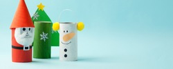 Merry christmas toy collection santa claus, snowman, tree on blue for Winter holiday concept background. Paper crafts, DIY. creative idea from toilet roll tube, banner