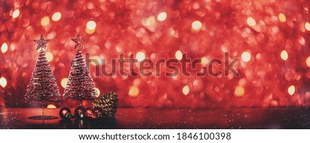 Photo of  Merry Christmas tree and happy new year background on red glitter sparkling string lights festive bokeh background.holiday celebration greeting card
