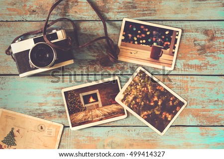 Merry christmas (xmas) photo album on old wood table. paper photo of film camera - vintage and retro style