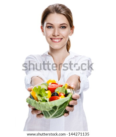merry european woman & vegetable salad / attractive girl of the european appearance after taking a shower eats a vegetable salad from transparent crockery - isolated on white background
