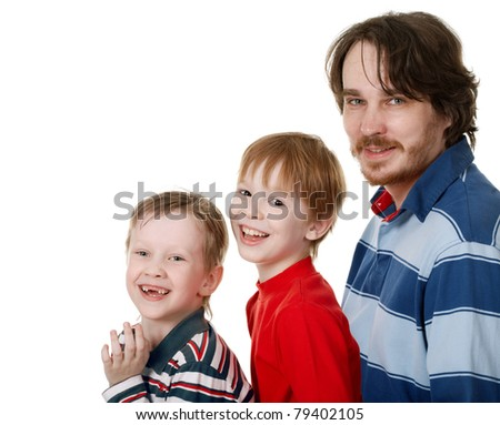 merry Family/His father and two sons, looked into the camera and laughing. Studio photography