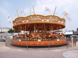 Merry go round, Antique style amusement ride.