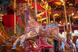 Merry go round carousel colourful horse with the name David painted on it taken at the Leeds Christmas German market in West Yorkshire UK