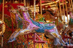Merry go round carousel colourful horse with the name Eileen painted on it taken at the Leeds Christmas German market in West Yorkshire UK