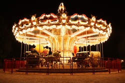 Merry-Go-Round (carousel) illuminated at night. The picture was taken near Paris, France