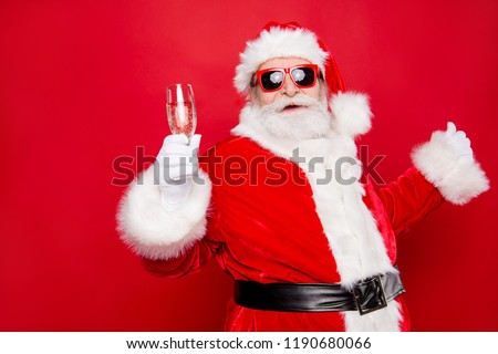 Merry holly careless festive newyear dreamy Santa chill out congratulations best wishes holding wineglass prepared ready isolated over bright vivid red background