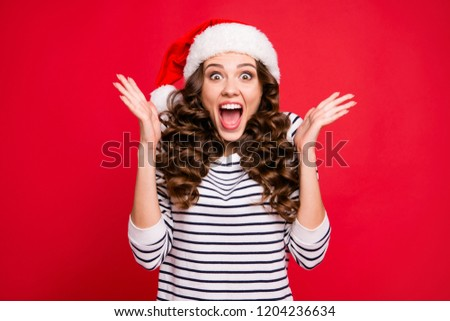 Merry holly x mas portrait of crazy cool cheerful glad positive optimistic charming curly-haired girl in casual striped pullover clapping palms waiting for gift isolated over red background
