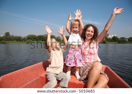 merry mother with the children in the boat