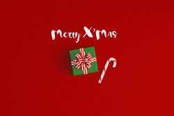 Merry X'mas  gift boxes with red ribbons viewed from top isolated on  color background