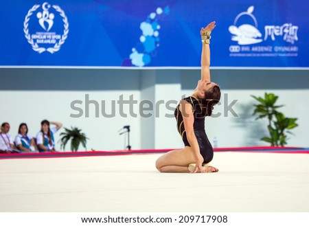 MERSIN, turkey - JUNE 21:  Saca Golob , Slovenia performs on the Floor Exercise  International Tournament in Artistic Gymnastic Mediterranean games Mersin, Turkey on June 21, 2013