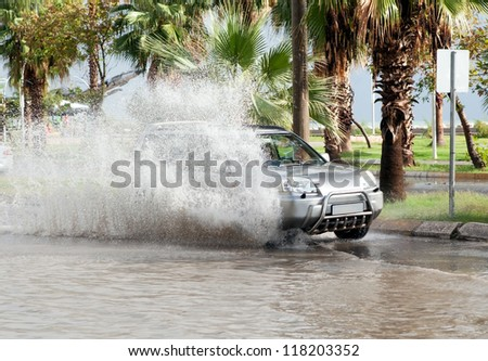 MERSIN - TURKEY - NOVEMBER 09, 2012: A lot of cars drive through flood,  Mersin beach strip 09 November 2012 Mersin - Turkey