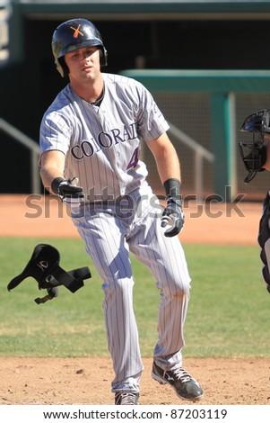 MESA, AZ - OCTOBER 17: Ben Paulsen a Colorado Rockies prospect, tosses away his shin protector after taking ball four in the Arizona Fall League Oct. 17, 2011 at HoHoKam Stadium. Paulsen went 0-for-3.