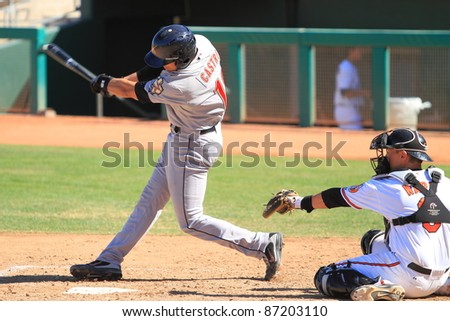 MESA, AZ - OCTOBER 17: Jason Castro, a catcher in the Houston Astros farm system, bats in an Arizona Fall League game Oct. 17, 2011 at HoHoKam Stadium. Castro went 0-for-3 but threw out a base runner.