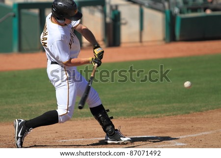 MESA, AZ - OCTOBER 17: Jerek Cunningham, a Pittsburgh Pirates prospect, smashes a three-run homer for the Mesa Solar Sox in an Arizona Fall League game Oct. 17, 2011 at HoHoKam Stadium.