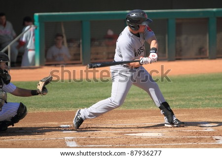 MESA, AZ - OCTOBER 26: Juan Carlos Linares, a Boston Red Sox prospect, bats for the Scottsdale Scorpions in an Arizona Fall League game Oct. 26, 2011 at HoHoKam Stadium, Mesa, AZ. Linares homered.