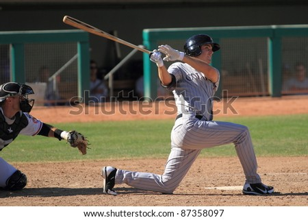 MESA, AZ - OCTOBER 17: Tim Weeler, a Double-A prospect for the Colorado Rockies, bats in an Arizona Fall League game on Oct. 17, 2011 at HoHoKam Stadium, Mesa, AZ. Wheeler doubled and drove in 3 for the Rafters.