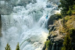 Mesa Falls, Idaho, USA Aug. 27, 2016 An experienced kayaker challenges the raging rapids of lower Mesa Falls on the Henry's  Fork of the Snake River, in Idaho.