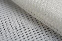 Mesh fabric close-up. Synthetic fiber fabric. Macro photo with bokeh.