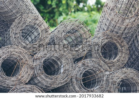 Mesh wire rolls of iron stainless steel, galvanized metal sheets construction material. Chicken wire mesh rolls farm fence. Net wire mesh roll engineer Construction galvanize malleable steel storage Сток-фото ©
