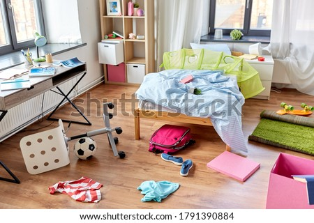 mess, disorder and interior concept - view of messy home kid's room with scattered stuff Stock fotó ©