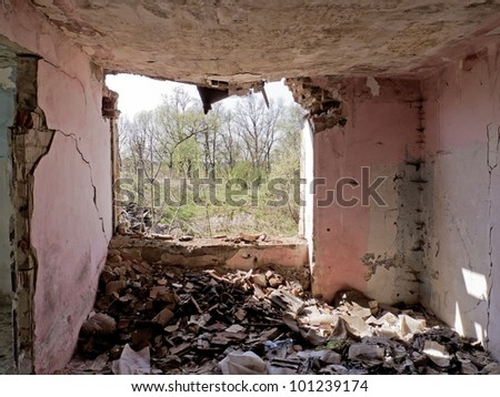 Mess in old broken house with lot of bricks