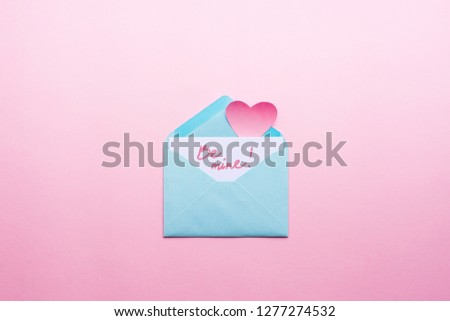 Message Be mine Blue letter with pink heart cartoon style from paper on cardboard background. Valentine day minimal concept Flat lay Top view #1277274532