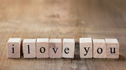 Message I love you spelled in wooden blocks with copy space