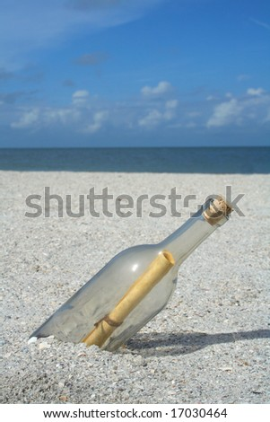 Message in a bottle buried in the sand