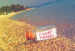 Message in a bottle Cheap travel on beach. Creative summer break and tourism concept.