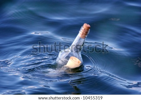 message in a bottle in a blue water