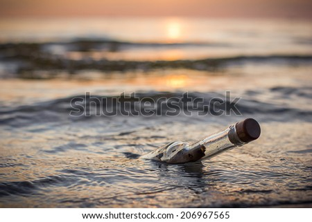 Message in a bottle in the sea sunset