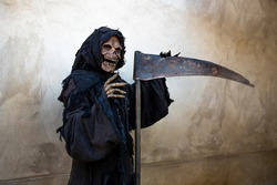 Message of Grim Reaper leaning against a scythe