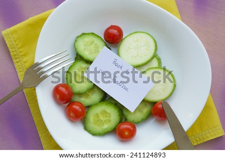 Message on the plate with raw vegetables: \