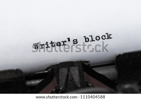 Message Writer's Block typed on an antique, old-fashioned  typewriter. Type is on an angle. Business concepts of writing, creativity, pressure, stress #1110404588