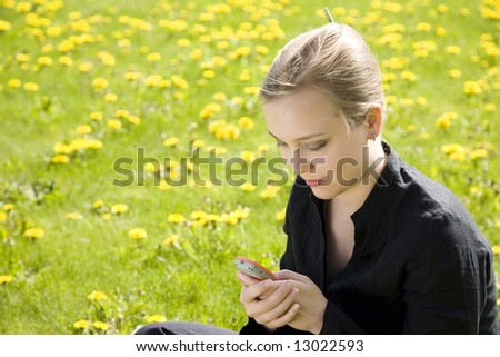 Message. Young Woman With Cell Phone.
