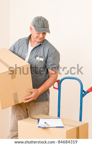 Messenger mature male courier delivering parcel boxes. Shipping and logistics.