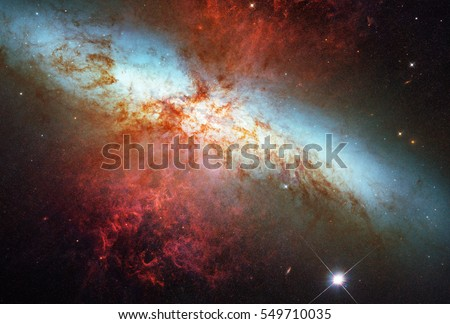 Messier 82, combining exposures, capture starlight from visible and infrared wavelengths as well as the light from the glowing hydrogen filaments, Elements of this image are furnished by NASA.\n
