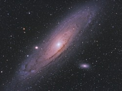 Messier 31 galaxy or also Andromeda in same constellation, with many stars as background in the deep space.