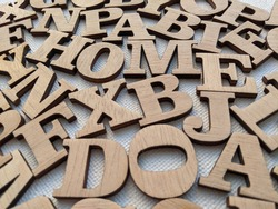 messy alphabet letters made of wood