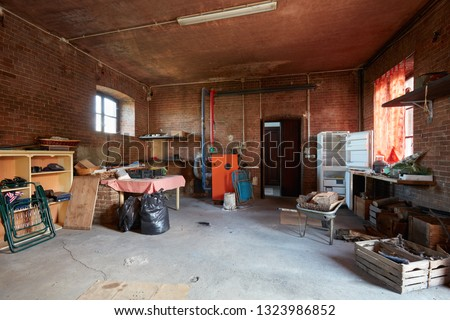 Messy basement with red bricks walls in old country house Foto stock ©