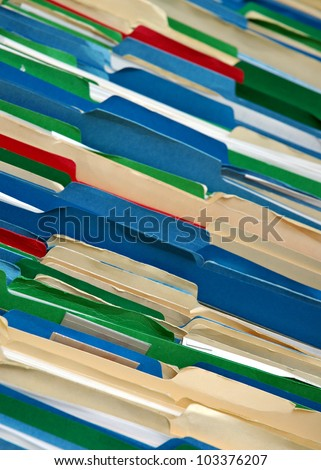 Messy filing cabinet with multi-colored file folders
